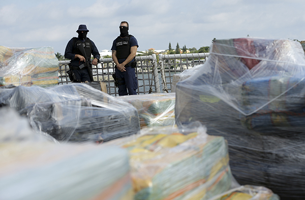 "<div class=""meta image-caption""><div class=""origin-logo origin-image ap""><span>AP</span></div><span class=""caption-text"">Coast Guardsmen stand over pallets containing more than 26 tons of cocaine worth at least $715 million on the flight deck of of 418-foot Coast Guard Cutter Hamilton. (AP Photo/Lynne Sladky)</span></div>"