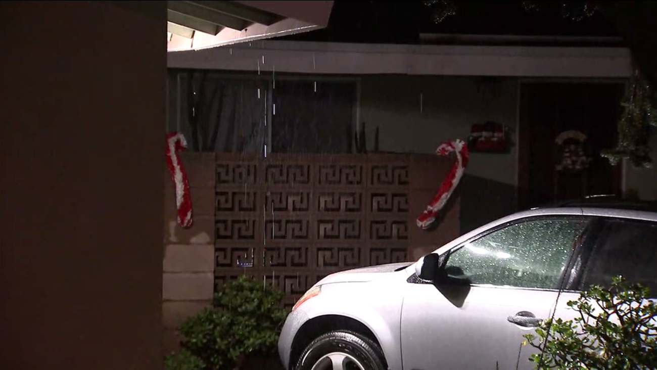 Rain falls from the roof of a home in Duarte during a storm that swept across Southern California on Friday, Dec. 16, 2016.