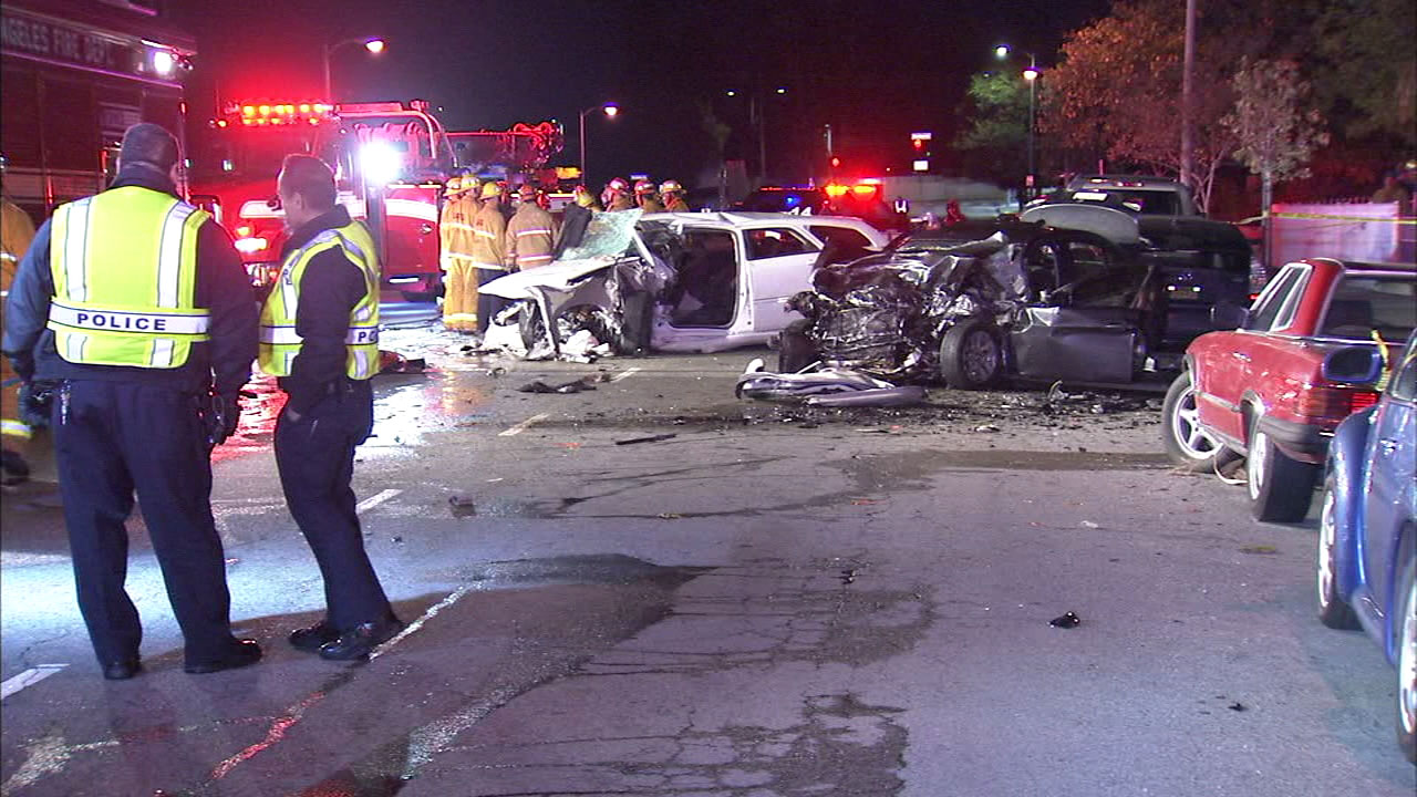 Firefighters at the scene of a car crash in Panorama City on Friday, Dec. 16, 2016.