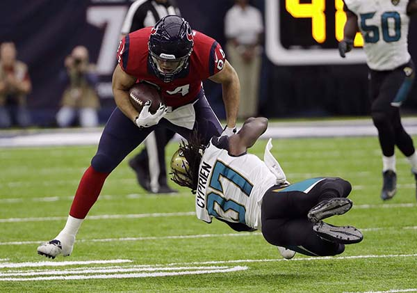 <div class='meta'><div class='origin-logo' data-origin='AP'></div><span class='caption-text' data-credit='AP'>Houston Texans tight end Ryan Griffin (84) is tackled by Jacksonville Jaguars' Johnathan Cyprien (37) during the first half of an NFL football game Sunday, Dec. 18, 2016</span></div>