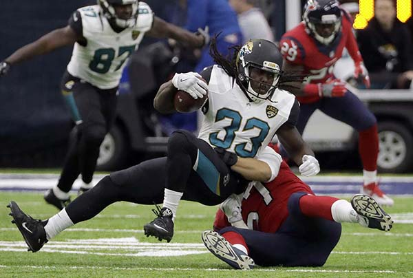 <div class='meta'><div class='origin-logo' data-origin='AP'></div><span class='caption-text' data-credit='AP'>Jacksonville Jaguars running back Chris Ivory (33) is tackled by Houston Texans linebacker Brennan Scarlett (57) during the first half of an NFL football game Sunday, Dec. 18, 2016</span></div>