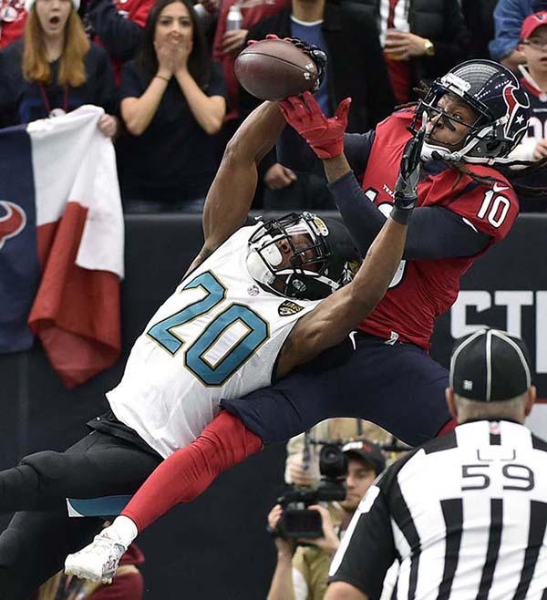 <div class='meta'><div class='origin-logo' data-origin='AP'></div><span class='caption-text' data-credit='AP'>Jacksonville Jaguars cornerback Jalen Ramsey (20) breaks up a pass in the end zone intended for Houston Texans' DeAndre Hopkins during the first half.</span></div>