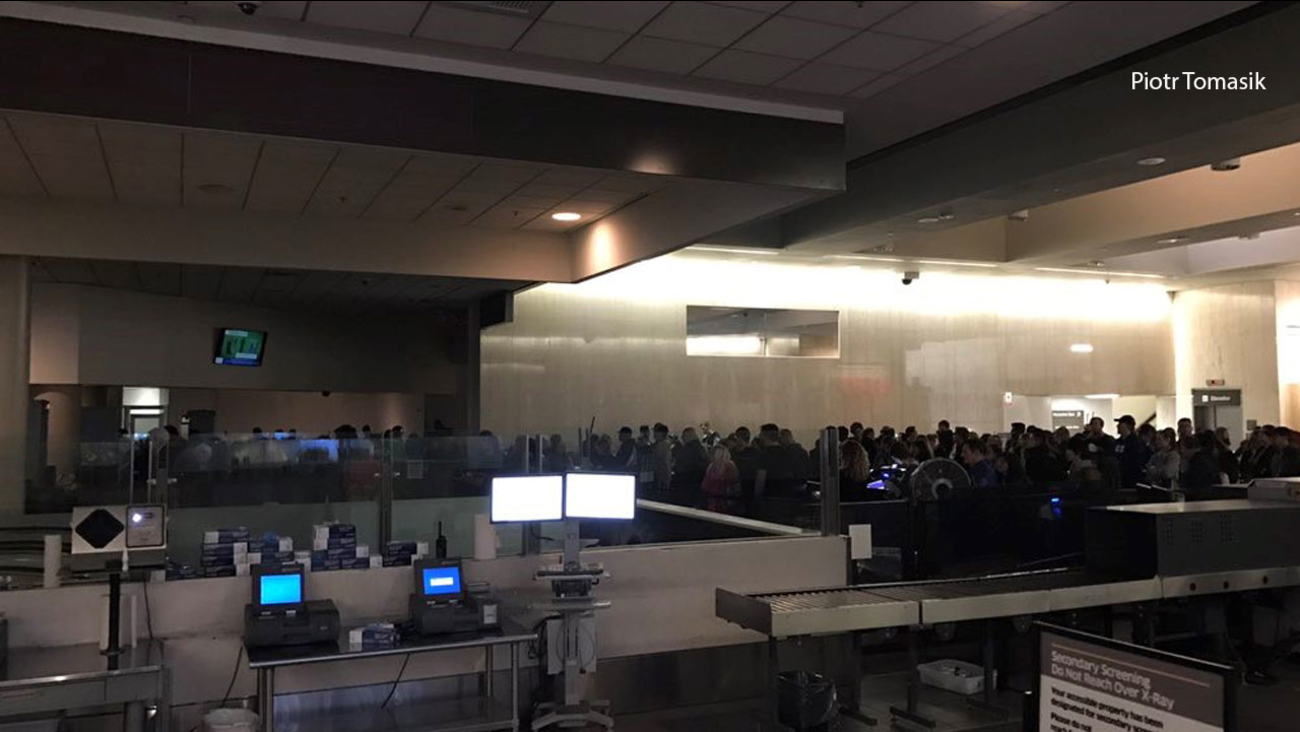 Darkness inside Los Angeles International Airport after a power outage on Sunday, Dec. 18, 2016.