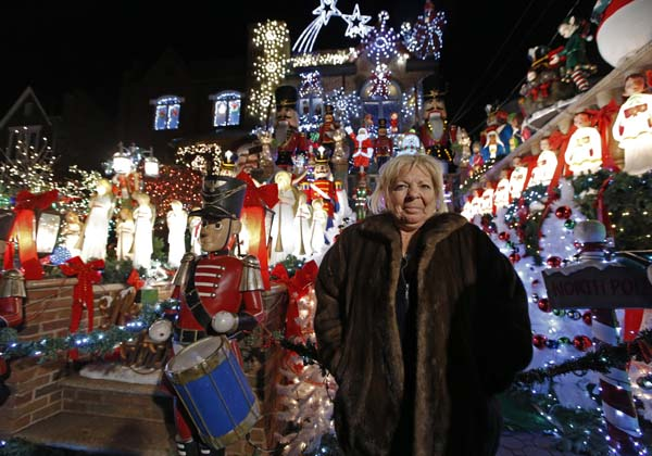 <div class='meta'><div class='origin-logo' data-origin='AP'></div><span class='caption-text' data-credit='AP Photo/Kathy Willens'>Dyker Heights resident Lucy Spata with her elaborate Christmas decorations</span></div>