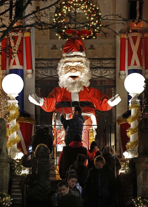 <div class='meta'><div class='origin-logo' data-origin='AP'></div><span class='caption-text' data-credit='AP Photo/Kathy Willens'>A giant animatronic Santa Claus towers over tourists taking photos at the elaborately-decorated Polizotto mansion in Dyker Heights</span></div>