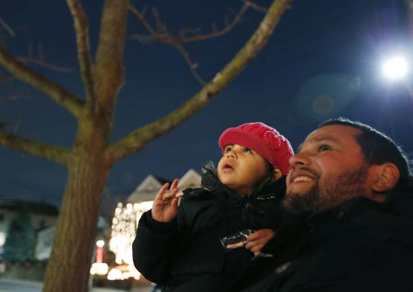 <div class='meta'><div class='origin-logo' data-origin='AP'></div><span class='caption-text' data-credit='AP Photo/Kathy Willens'>Jeffrey Diaz and his daughter Isabella look at a display of Christmas lights in the Dyker Heights neighborhood</span></div>