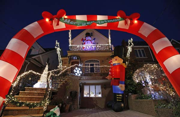 <div class='meta'><div class='origin-logo' data-origin='AP'></div><span class='caption-text' data-credit='AP Photo/Kathy Willens'>An inflatable archway adorns a private home in the Dyker Heights neighborhood of Brooklyn</span></div>