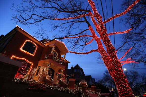 <div class='meta'><div class='origin-logo' data-origin='AP'></div><span class='caption-text' data-credit='AP Photo/Kathy Willens'>A house and tree are decorated for Christmas in the Brooklyn neighborhood of Dyker Heights</span></div>