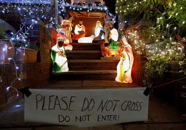 <div class='meta'><div class='origin-logo' data-origin='AP'></div><span class='caption-text' data-credit='AP Photo/Kathy Willens'>A sign warning spectators not to come onto the property is hung in front of a lighted creche display in the Dyker Heights</span></div>