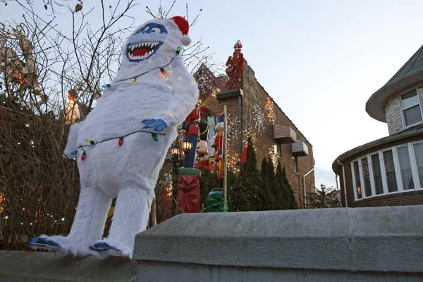 <div class='meta'><div class='origin-logo' data-origin='AP'></div><span class='caption-text' data-credit='AP Photo/Kathy Willens'>An abominable snowman figure wearing Christmas lights stands is displayed on  a concrete wall in front of a home in the Dyker Heights neighborhood of Brooklyn</span></div>