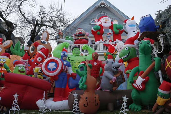 <div class='meta'><div class='origin-logo' data-origin='AP'></div><span class='caption-text' data-credit='AP Photo/Kathy Willens'>Dozens of inflatable creatures carpet the front lawn of a home in the Dyker Heights neighborhood</span></div>