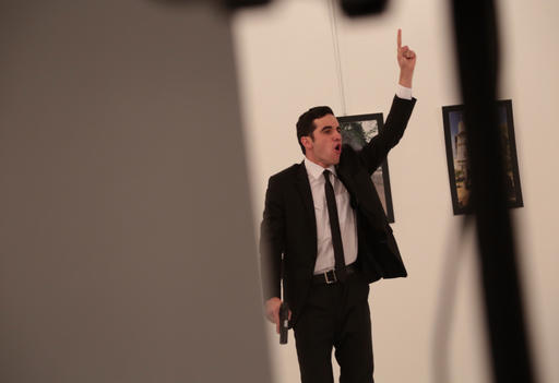 <div class='meta'><div class='origin-logo' data-origin='AP'></div><span class='caption-text' data-credit='Burhan Ozbilici'>An unnamed gunman gestures after shooting the Russian Ambassador to Turkey, Andrei Karlov, at a photo gallery in Ankara, Turkey, Monday, Dec. 19, 2016.</span></div>