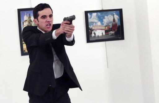 "<div class=""meta image-caption""><div class=""origin-logo origin-image ap""><span>AP</span></div><span class=""caption-text"">An unnamed gunman gestures after shooting the Russian Ambassador to Turkey, Andrei Karlov, at a photo gallery in Ankara, Turkey, Monday, Dec. 19, 2016. (Burhan Ozbilici)</span></div>"