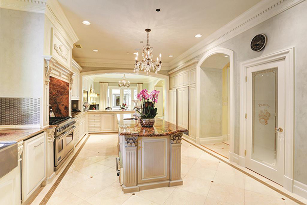 "<div class=""meta image-caption""><div class=""origin-logo origin-image none""><span>none</span></div><span class=""caption-text"">Another view of this fabulous kitchen. Marble floors, crown molding, recessed lighting, crystal chandelier, tiled back splash, bronze sink 48"" viking & sub zero built in fridge. (Courtesy Houston Association of Realtors)</span></div>"