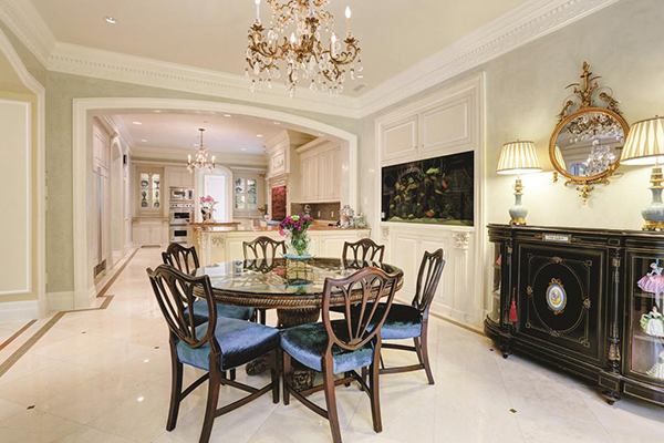 "<div class=""meta image-caption""><div class=""origin-logo origin-image none""><span>none</span></div><span class=""caption-text"">Large breakfast area with marble floors, French doors with silk drapes open to pool terrace. (Courtesy Houston Association of Realtors)</span></div>"