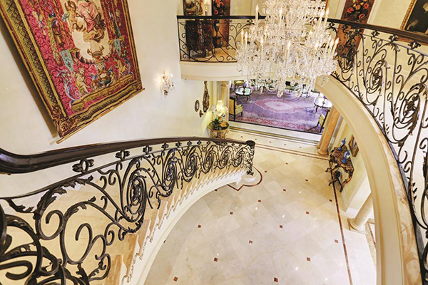 "<div class=""meta image-caption""><div class=""origin-logo origin-image none""><span>none</span></div><span class=""caption-text"">View of the grand entry and the beautiful stair case taken from the second floor. (Courtesy Houston Association of Realtors)</span></div>"