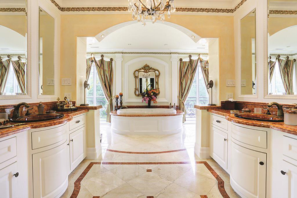 "<div class=""meta image-caption""><div class=""origin-logo origin-image none""><span>none</span></div><span class=""caption-text"">Lavish master bath with two vanities, two water closets and three separate large walk-in closets. (Courtesy Houston Association of Realtors)</span></div>"