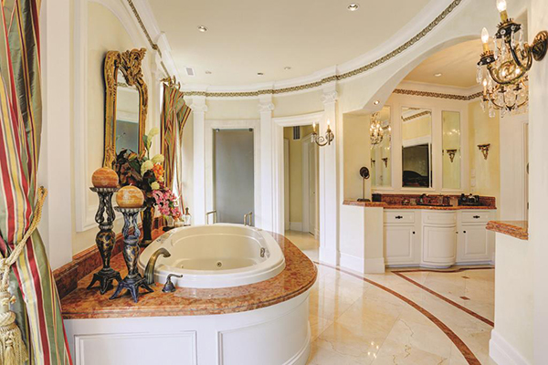 "<div class=""meta image-caption""><div class=""origin-logo origin-image none""><span>none</span></div><span class=""caption-text"">Another view of the master bath with marble counter tops and floors, decorative carved pilasters. Marble shower w/dual fixtures. Air tub w/ marble surround. (Courtesy Houston Association of Realtors)</span></div>"