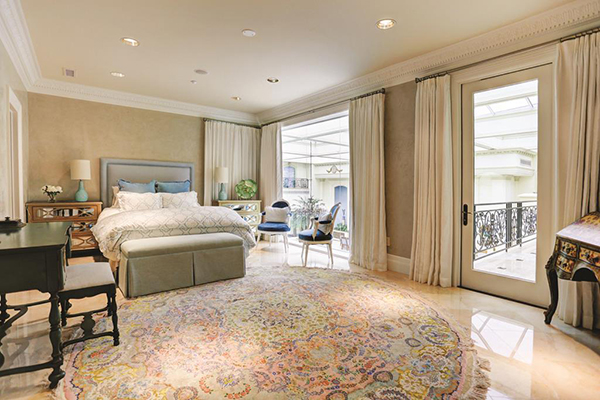"<div class=""meta image-caption""><div class=""origin-logo origin-image none""><span>none</span></div><span class=""caption-text"">One of the many secondary or guest bedrooms with marble floors recessed lighting and speakers, private bath featuring marble floors, vanity w/ granite top & knee space. (Courtesy Houston Association of Realtors)</span></div>"