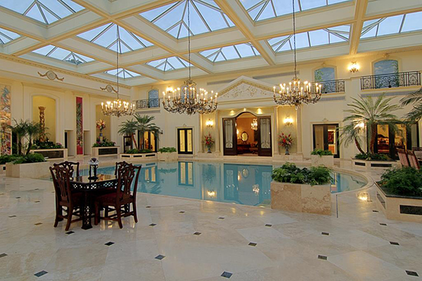 "<div class=""meta image-caption""><div class=""origin-logo origin-image none""><span>none</span></div><span class=""caption-text"">50,000 gallons saltwater swimming pool (7' deep). Marble floors with decorative insets. Multiple lighted sconces, custom hand painted murals framed with marble columns. (Courtesy Houston Association of Realtors)</span></div>"