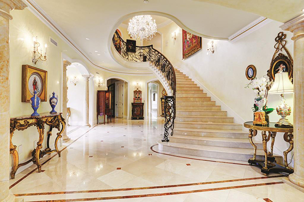 "<div class=""meta image-caption""><div class=""origin-logo origin-image none""><span>none</span></div><span class=""caption-text"">Grand reception hall with marble floors throughout. Reclaimed antique chandelier w/electronic lift, curved stairs w/marble steps, custom iron balustrade & hand painted dome ceiling (Courtesy Houston Association of Realtors)</span></div>"