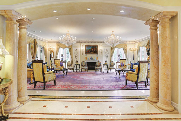 "<div class=""meta image-caption""><div class=""origin-logo origin-image none""><span>none</span></div><span class=""caption-text"">Elegantly designed arched grand entry with marble columns leading to a magnificent formal living room. (Courtesy Houston Association of Realtors)</span></div>"