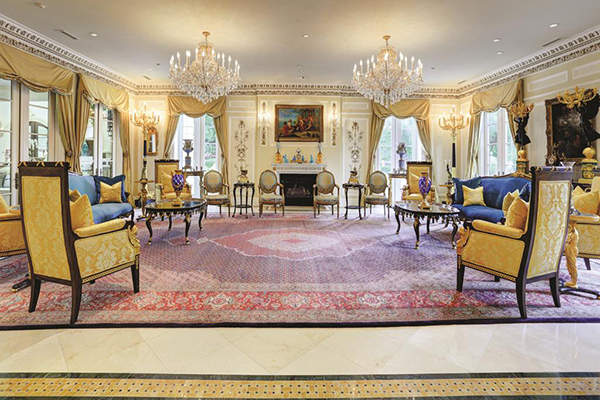 "<div class=""meta image-caption""><div class=""origin-logo origin-image none""><span>none</span></div><span class=""caption-text"">Huge formal living room. Decorative crown molding w/22 karat gold accents, recessed lighting & speakers, paneled walls, 2 crystal chandeliers & 4 sets of lighted sconces. (Courtesy Houston Association of Realtors)</span></div>"
