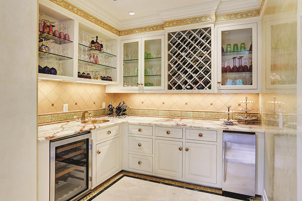 "<div class=""meta image-caption""><div class=""origin-logo origin-image none""><span>none</span></div><span class=""caption-text"">Wet Bar located off the formal living with mini fridge, ice maker, built ins and marble counter tops and floors (Courtesy Houston Association of Realtors)</span></div>"