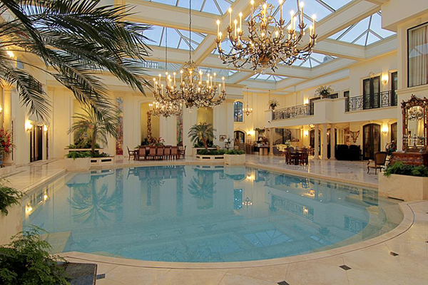 "<div class=""meta image-caption""><div class=""origin-logo origin-image none""><span>none</span></div><span class=""caption-text"">50,000 gallons saltwater swimming pool (7' deep). Marble floors with decorative insets. Multiple lighted sconces, custom hand painted murals depicting. (Courtesy Houston Association of Realtors)</span></div>"
