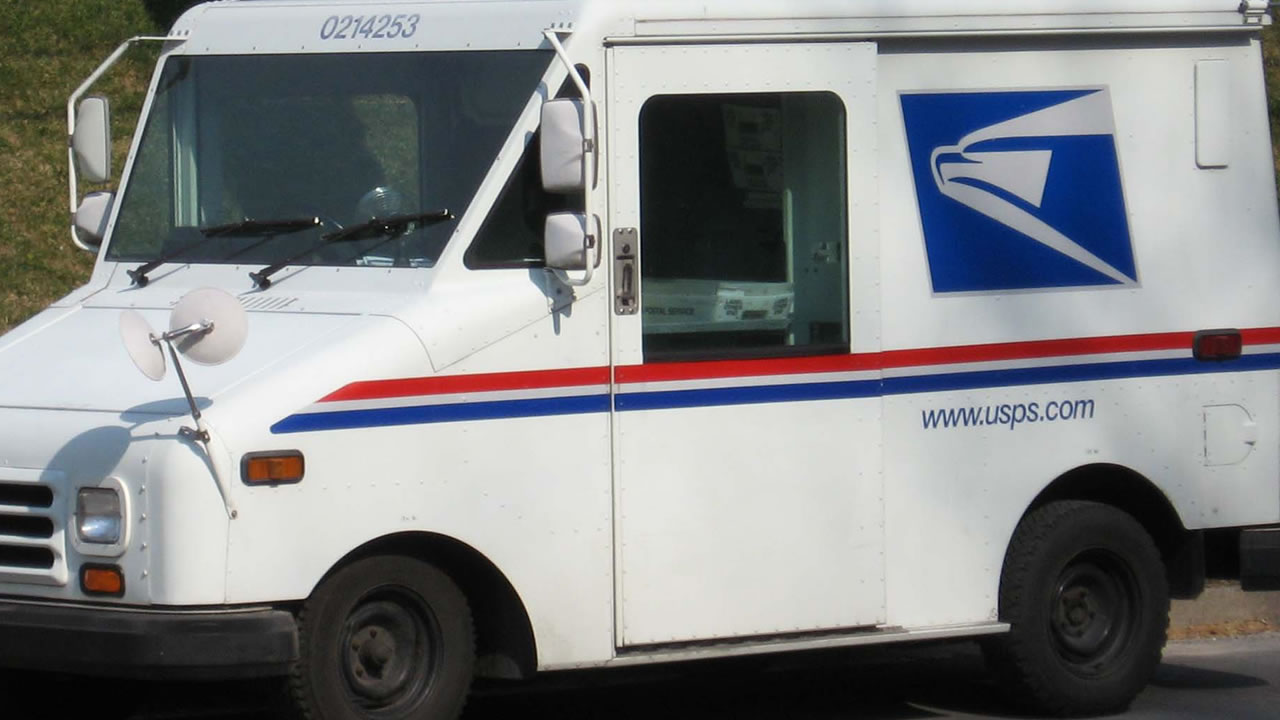 USPS mail truck (image source Wikimedia Commons public domain)