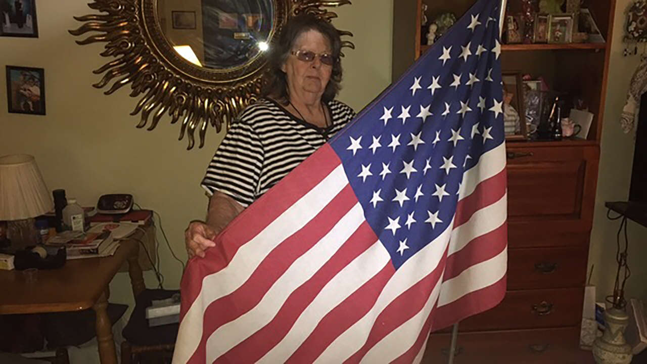 A woman in Gastonia was told to take down her American flag or lose benefits