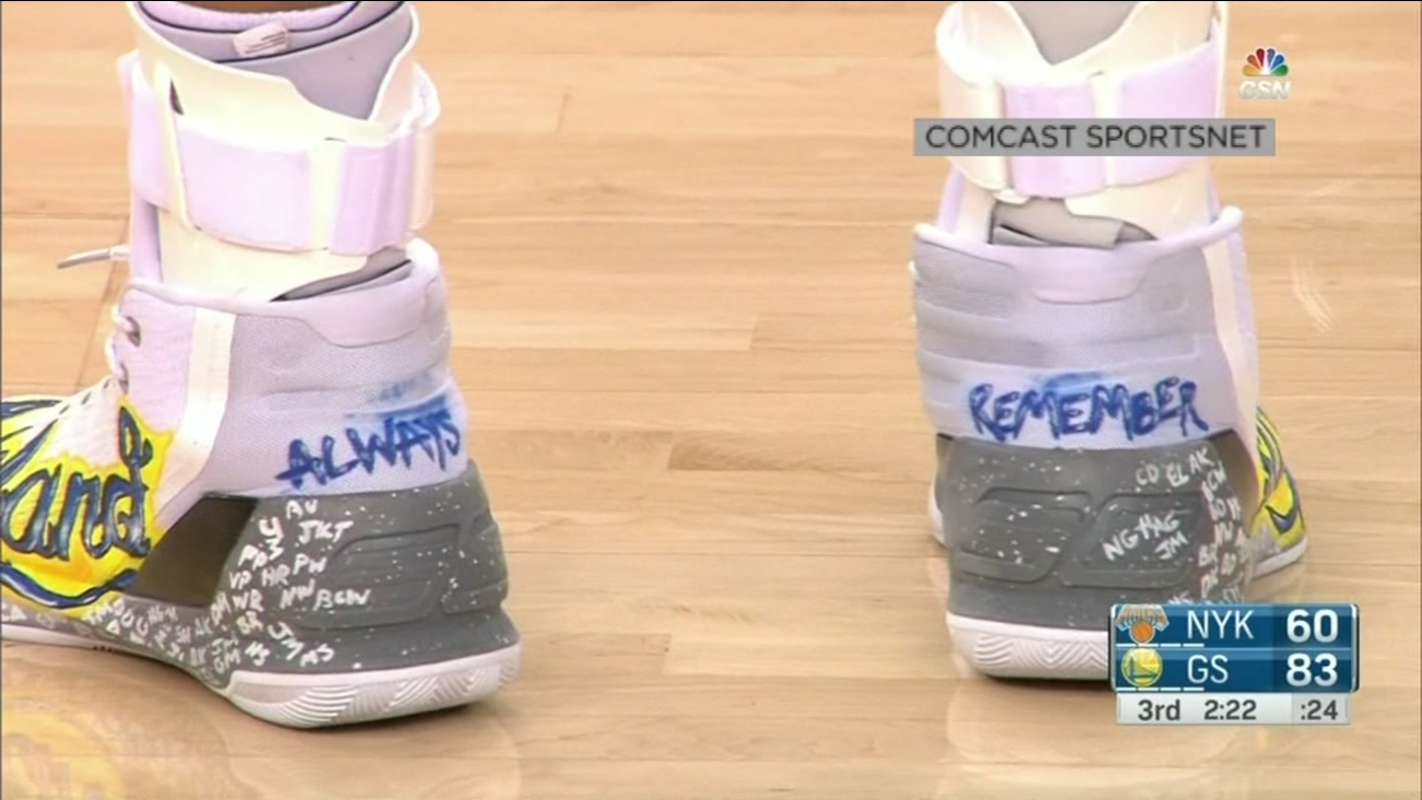 This is an undated image of Steph Curry wearing shoes dedicated to the victims of the Ghost Ship fire in Oakland, Calif.