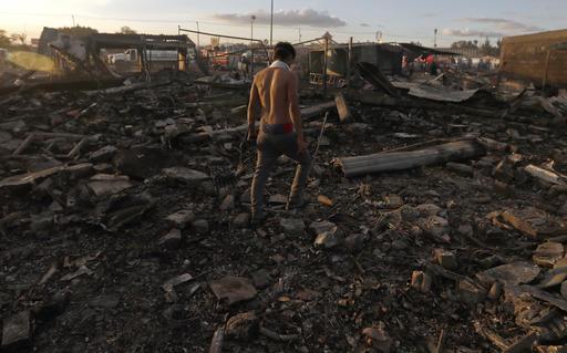 "<div class=""meta image-caption""><div class=""origin-logo origin-image ap""><span>AP</span></div><span class=""caption-text"">A man walks  through the scorched ground of the open-air San Pablito fireworks market, in Tultepec, outskirts of Mexico City, Mexico, Tuesday, Dec. 20, 2016. (AP Photo/Eduardo Verdugo)</span></div>"
