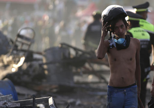 <div class='meta'><div class='origin-logo' data-origin='AP'></div><span class='caption-text' data-credit='AP Photo/Eduardo Verdugo'>A boy takes his helmet off as he pauses while working at the scorched ground of the open-air San Pablito fireworks market, in Tultepec, outskirts of Mexico City, Mexico.</span></div>