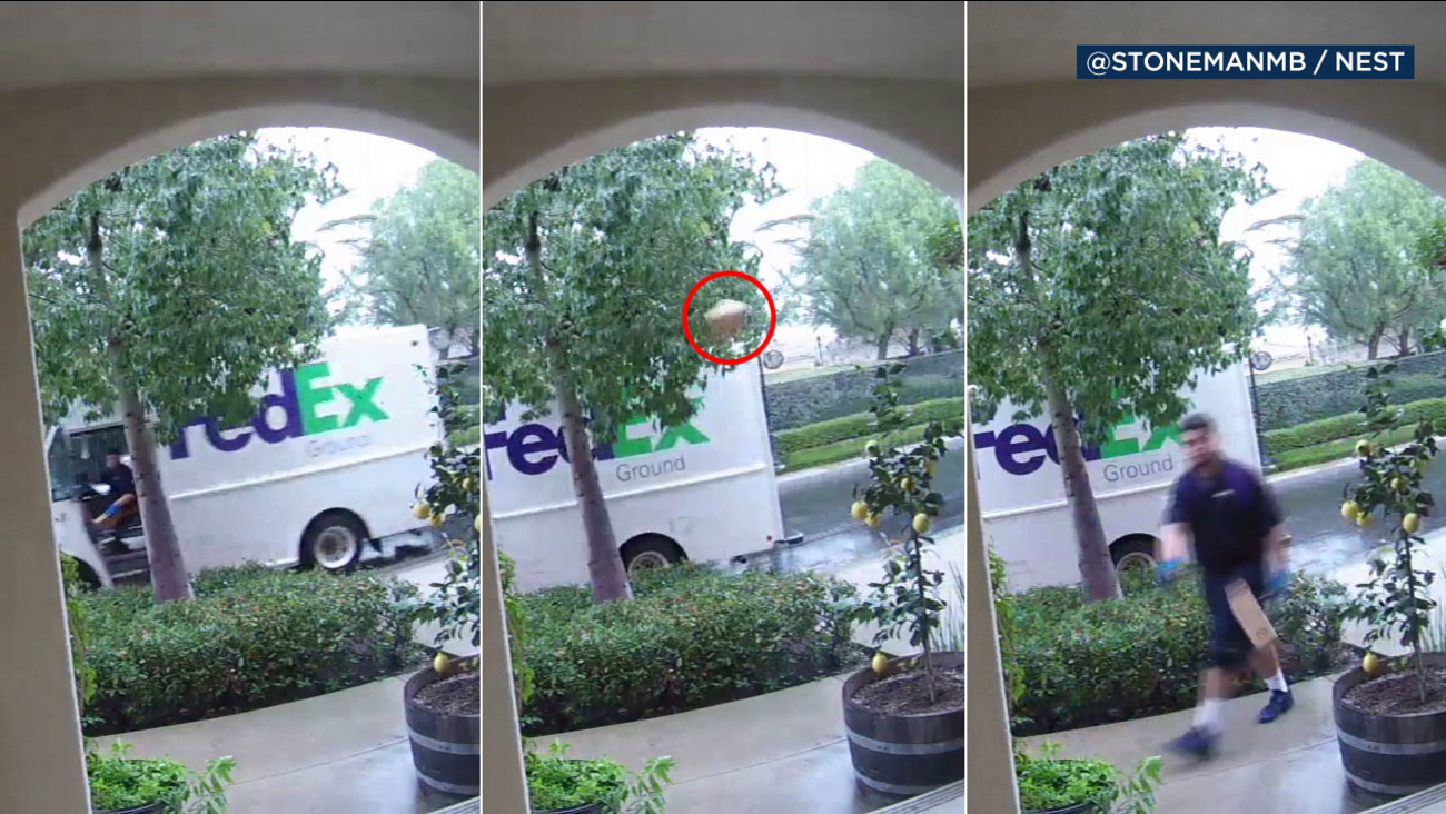 A FedEx driver is captured on video pulling up to an Irvine home, throwing a package from his truck and then retrieving the box and carelessly tossing it onto the porch.