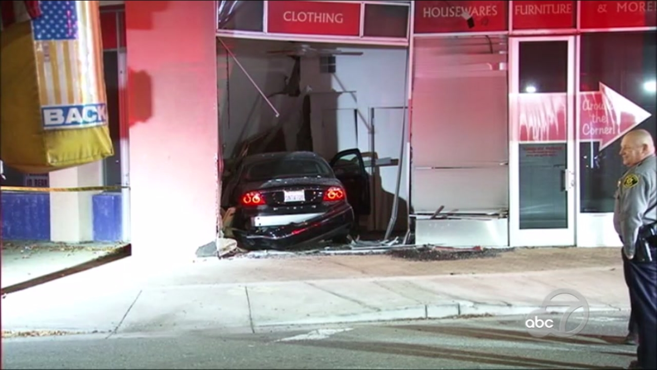 Police are investigating after a car plowed into a thrift store in San Leandro, Calif. on Thursday, Dec. 22, 2016.