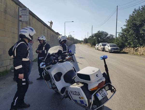 <div class='meta'><div class='origin-logo' data-origin='AP'></div><span class='caption-text' data-credit='AP Photo/Jonathan Borg'>Maltese police officers close off a road by Malta's Luqa International airport after an Afriqiyah Airways plane from Libya landed at the airport in an apparent hijack</span></div>