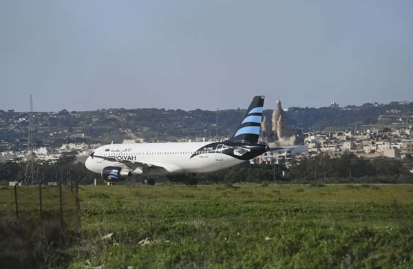 <div class='meta'><div class='origin-logo' data-origin='AP'></div><span class='caption-text' data-credit='AP Photo/Jonathan Borg'>An Afriqiyah Airways plane from Libya stands on the tarmac at Malta's Luqa International airport, Friday, Dec. 23, 2016</span></div>