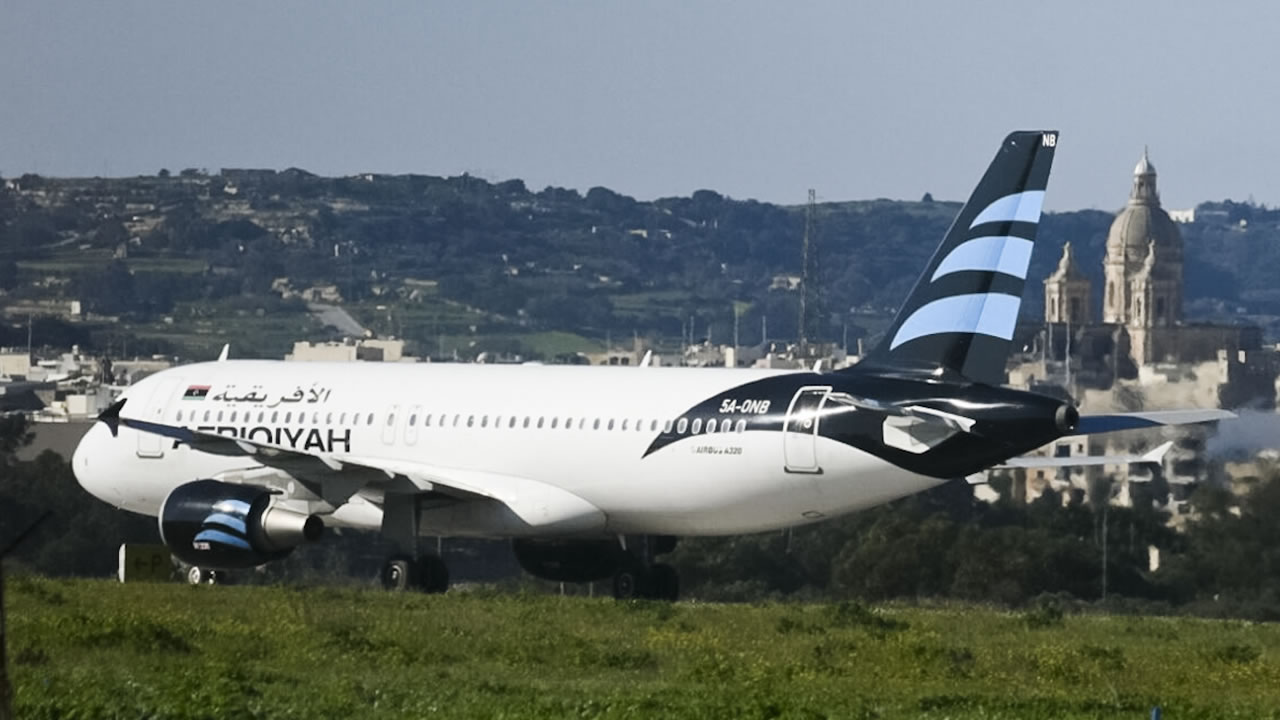 An Afriqiyah Airways plane from Libya stands on the tarmac at Malta's Luqa International airport, Friday, Dec. 23, 2016.