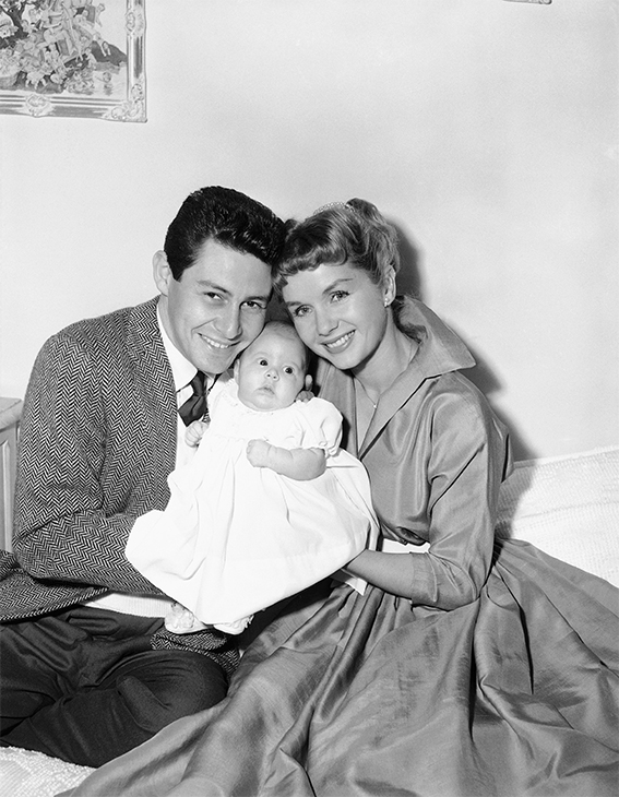 <div class='meta'><div class='origin-logo' data-origin='none'></div><span class='caption-text' data-credit='AP Photo'>Eddie Fisher and Debbie Reynolds with their young daughter, Carrie Frances Fisher, in Hollywood, Jan. 2, 1957.</span></div>