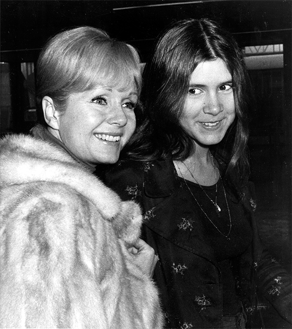 <div class='meta'><div class='origin-logo' data-origin='none'></div><span class='caption-text' data-credit='AP Photo'>Debbie Reynolds, left, and her daughter Carrie Fisher, 15, are en route to Madrid at Heathrow Airport in London, England, Feb. 12, 1972.</span></div>