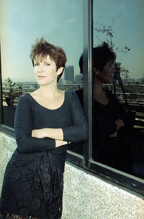 <div class='meta'><div class='origin-logo' data-origin='none'></div><span class='caption-text' data-credit='Julie Markes/AP'>Actress and author Carrie Fisher is seen in Beverly Hills, Calif., Sept. 14, 1990.</span></div>