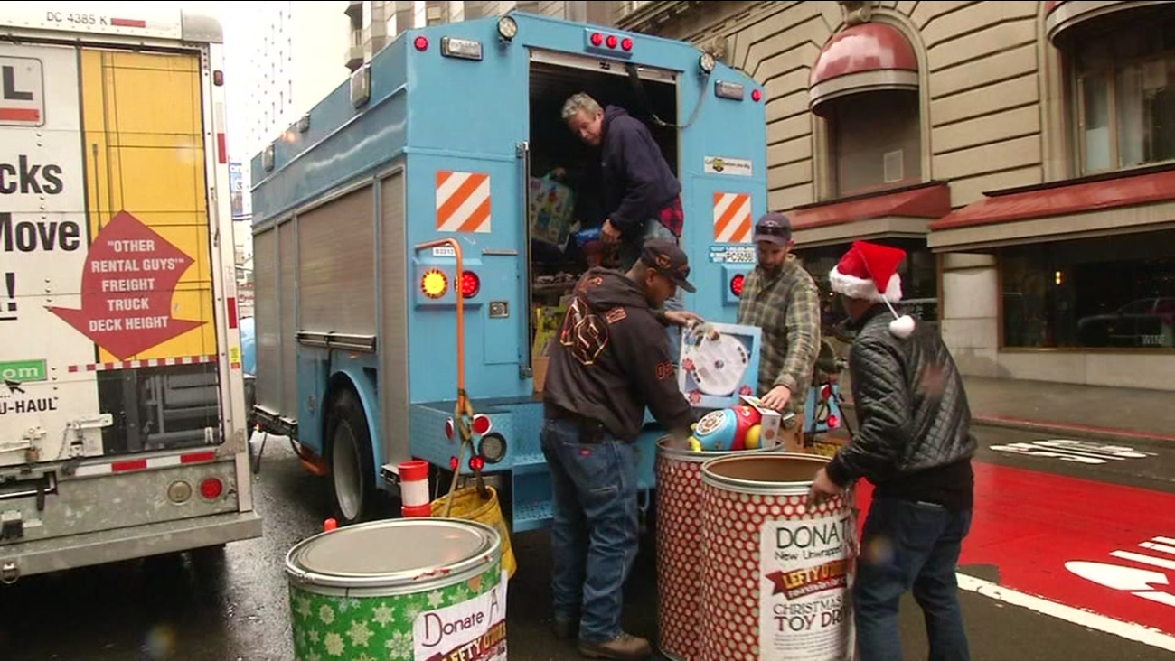 Crews unload toys for kids in front of Lefty O'Douls restaurant in San Francisco, Calif. on Friday, December 23, 2016.