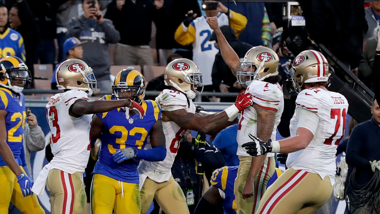 San Francisco 49ers quarterback Colin Kaepernick celebrates after scoring a two-point conversion against the Los Angeles Rams at the Coliseum on Saturday, Dec. 24, 2016.