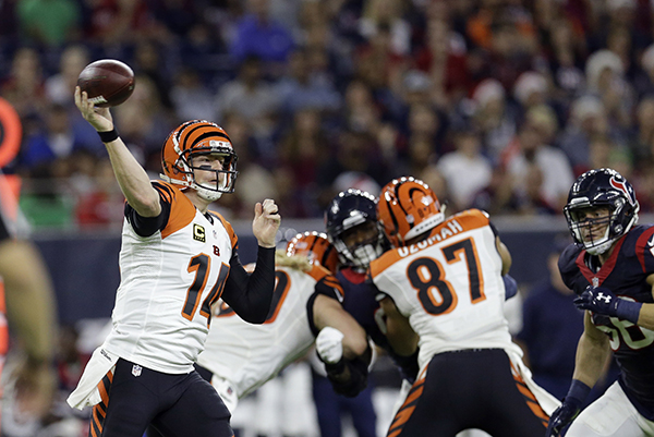 <div class='meta'><div class='origin-logo' data-origin='AP'></div><span class='caption-text' data-credit='AP Photo/Eric Christian Smith'>Cincinnati Bengals quarterback Andy Dalton (14) throws a pass against the Houston Texans during the first half of an NFL football game Saturday, Dec. 24, 2016, in Houston.</span></div>