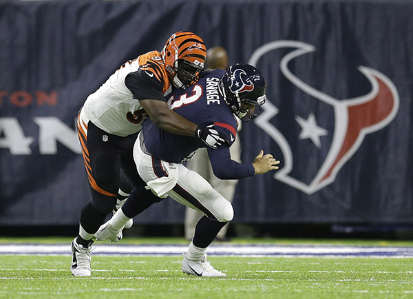 <div class='meta'><div class='origin-logo' data-origin='AP'></div><span class='caption-text' data-credit='AP Photo/Eric Christian Smith'>Houston Texans quarterback Tom Savage (3) is sacked by Cincinnati Bengals defensive tackle Geno Atkins (97) during the first half of an NFL football game.</span></div>