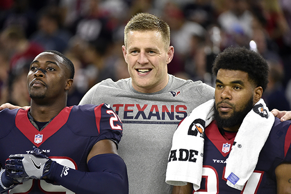 <div class='meta'><div class='origin-logo' data-origin='AP'></div><span class='caption-text' data-credit='AP Photo/Eric Christian Smith'>Houston Texans defensive end J.J. Watt, center, stands on the sidelines with teammates Andre Hal (29) and Quintin Demps (27) during the first half of an NFL football game.</span></div>