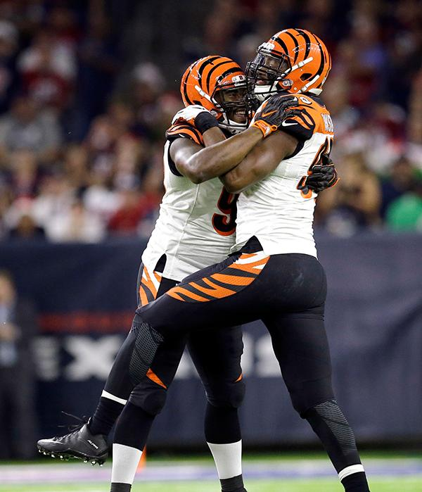 <div class='meta'><div class='origin-logo' data-origin='AP'></div><span class='caption-text' data-credit='(AP Photo/Sam Craft)'>Cincinnati Bengals' Wallace Gilberry, left, and Michael Johnson celebrate after sacking Houston Texans quarterback Tom Savage.</span></div>