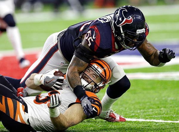 "<div class=""meta image-caption""><div class=""origin-logo origin-image ap""><span>AP</span></div><span class=""caption-text"">Cincinnati Bengals running back Rex Burkhead (33) is hit by Houston Texans inside linebacker Benardrick McKinney (55) during the second half of an NFL football game. (AP Photo/Sam Craft)</span></div>"