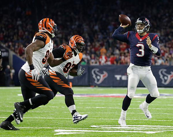 <div class='meta'><div class='origin-logo' data-origin='AP'></div><span class='caption-text' data-credit='AP Photo/Sam Craft'>Houston Texans quarterback Tom Savage (3) throws an incomplete pass as Cincinnati Bengals defensive end Michael Johnson (90) and defensive tackle Geno Atkins (97) defend.</span></div>